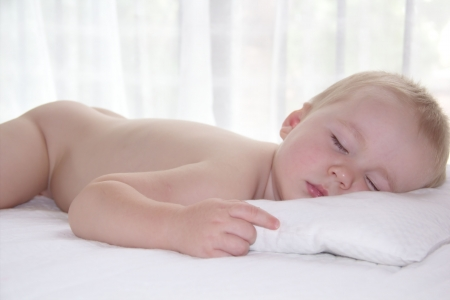 Cute little one year old boy is having a nap Stock Photo - 18442491