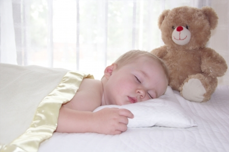 One year old boy is sleeping under the blanket Stock Photo - 18442495