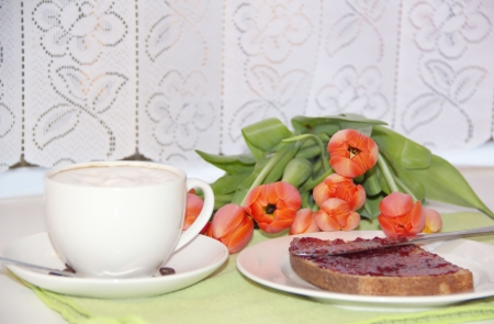 Breakfast - cup of coffee and a toast with jam