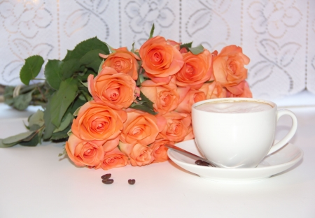 A cup of coffee and a bouquet of rose flowers Stock Photo