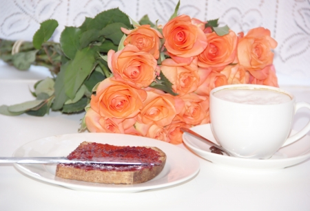 Breakfast - cup of coffee and a toast with strawberry jam photo