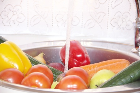 Vegetables  in a sink  is washing Stock Photo - 18618956