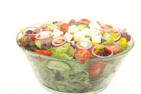 Vitamin healthy salad in a big bowl isolated on white background