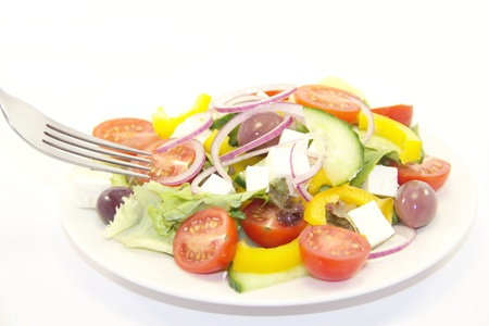 Fresh healthy vegetable salad in a plate on white photo