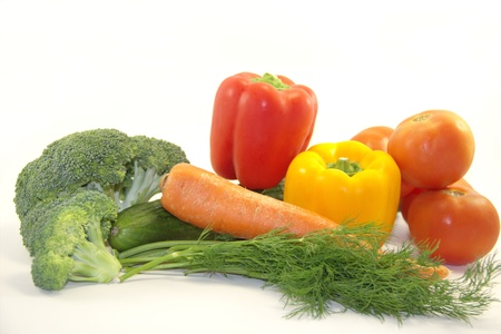Fresh bright vegetables isolated on white photo