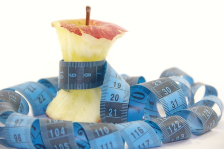 apple core: Apple core with a blue tape measure Stock Photo