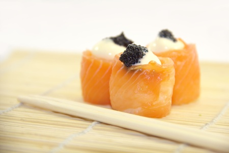 tobikko: Tasty rolls with salmon, cream cheese and caviar Stock Photo