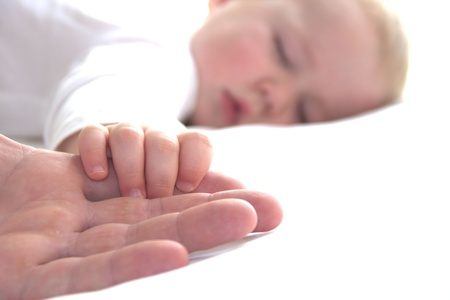 day dream: Sleeping boy is holding fathers hand Stock Photo