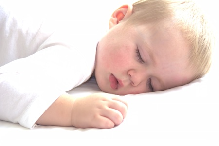 Little cute toddler boy is having a nap photo