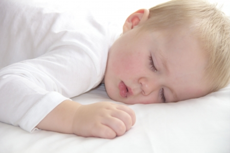 sleeping room: Little toddler one year old boy is napping Stock Photo