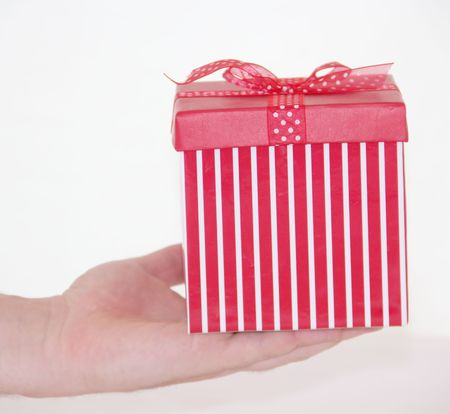 Man is giving the red present gift box