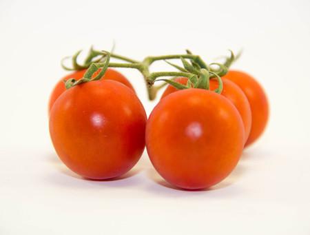 Fresh tomatoes isolated on white background Stock Photo