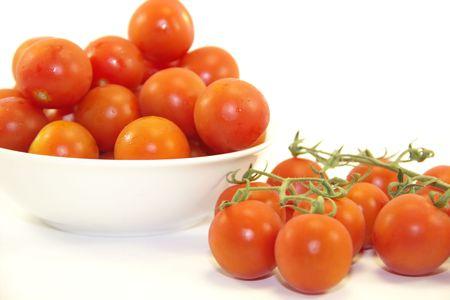 Fresh cherry tomatoes on white background