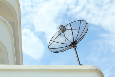 Satellite dish the parabolic shape of a dish reflects the signal to the dish's focal point. Mounted on brackets at the dishs focal point is a   device called a feedhorn photo