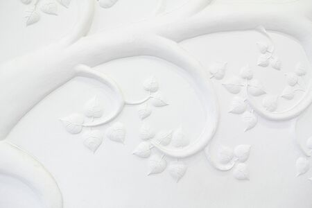 This low-relief sculpture plaster white trees