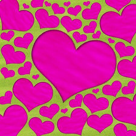 Pink heart-shaped pond in the meadow photo