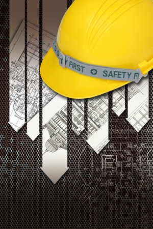 construction safety: Helmet of constructor with blueprints building construction