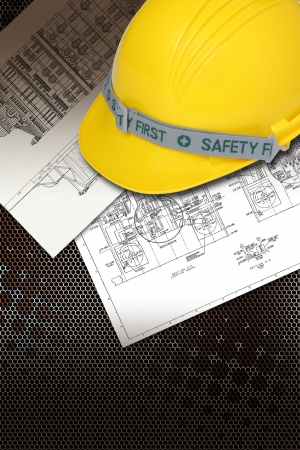 Helmet of constructor with blueprints building construction photo