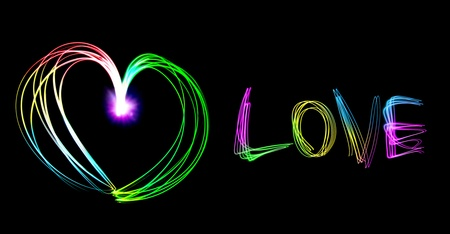 Heart shape and love letter drawing by flashlight multiple color in the night Stock Photo