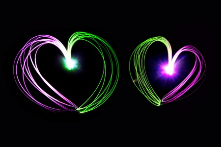 heart shape drawing by flashlight in the night Stock Photo