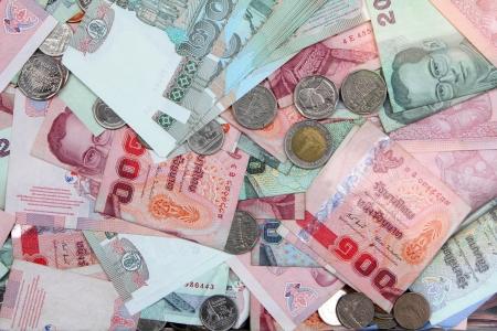 Thai money pile bill and coins