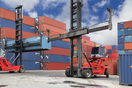 Forklift working in container yard  Stock Photo