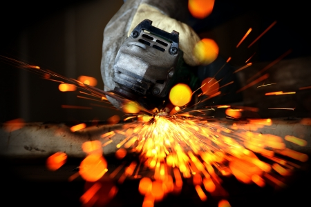 hand drill: metal sawing close up with sparking Stock Photo