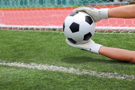 Cliping pad zijn Doelman genoemd goaltender, netminder, goalie is een aangewezen speler geladen met direct voorkomen dat de tegenpartij van de lijn halen door het onderscheppen van schoten op doel Stockfoto