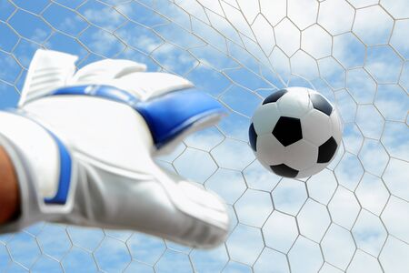 termed: Goalkeeper  termed goaltender, netminder, goalie, or keeper in some sports  is a designated player charged with directly preventing the opposing team from scoring by intercepting shots at goal  Stock Photo