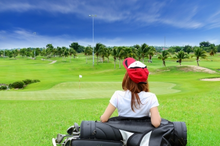 woman golf: A golf course comprises a series of holes, each consisting of a teeing ground, a fairway, the rough and other hazards, and a green with a flagstick  and hole, all designed for the game of golf
