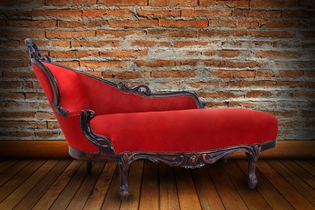 red chair: Red sofa in sitting-room with brick wall Stock Photo