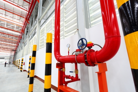 Show water system in warehouse pipes valves and pressure gauge for service when warehouse run Stock Photo
