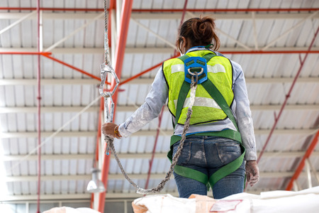 zip: A safety harness is a form of protective equipment designed to protect a person, animal, or object from injury or damage. The harness is an attachment between a stationary and non-stationary object Stock Photo