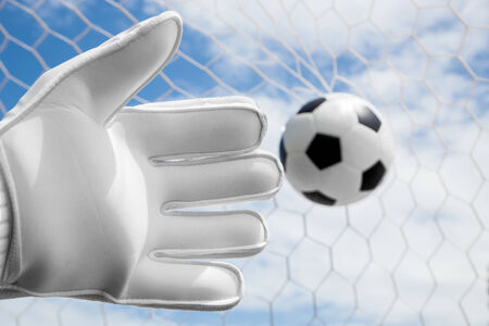 termed: Goalkeeper (termed goaltender, netminder, goalie, or keeper in some sports) is a designated player charged with directly preventing the opposing team from scoring by intercepting shots at goal.  Stock Photo
