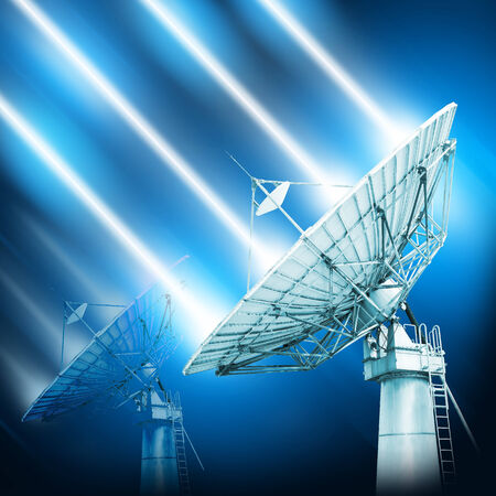 transmit: A satellite dish is a dish-shaped type of parabolic antenna designed to receive microwaves from communications satellites, which transmit data transmissions or broadcasts, such as satellite television Stock Photo