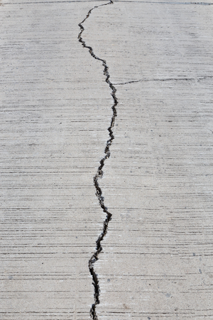 The road surface was damaged due to heavy use, vehicle overweight defined Stock Photo