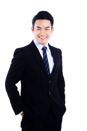 Portrait Young businessman in black suit standing and smiling with feeling about happiness in successful Stock Photo