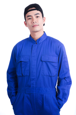 Young engineer in blue uniform suit wearing a hat and pose acting in portrait shot