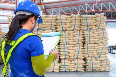 stacked sacks in store. A warehouse is a commercial building for storage. Warehouses are used by manufacturers, importers, exporters, wholesalers, 