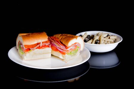 sandwitch: An Italian grinder with a side of pasta salad. Stock Photo