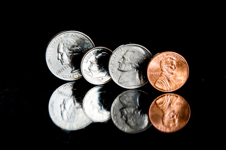 All coins on edge with a black background.