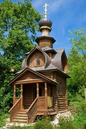 An old orthodox log wooden chapel near St. Savas spring, Sergiev Posad, Russia photo