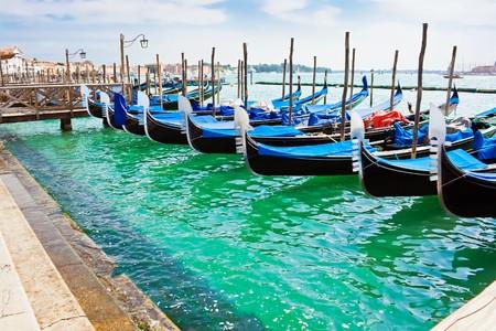 Blue and black gondola boats moored in Venice Stock Photo - 4350099