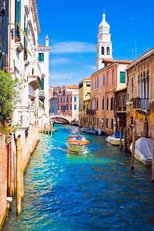 A boat in a canal in Venice, Italy photo