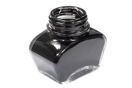 small jar of black writing ink on an isolated background