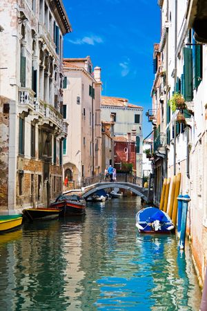green and blue water of a typical venetian canal, Italy