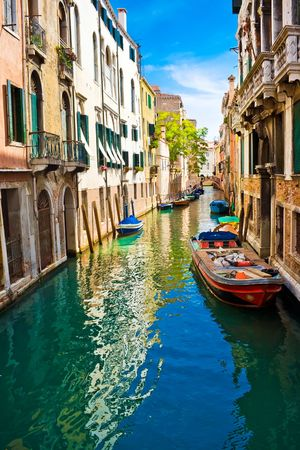 blue and green water of a venetian canal, Italy Stock Photo