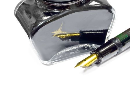 A jar of black writing ink and fountain pen Stock Photo - 4682095