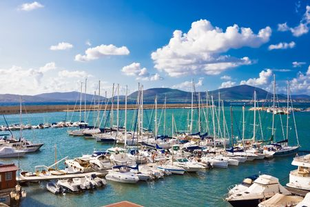 Classic white yachts ancored in the port of Alghero, Sardinia Stock fotó