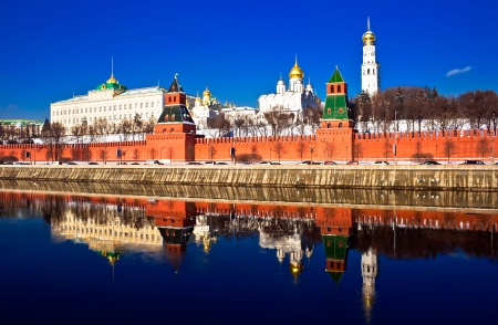 city square: The red brick walls of famous Kremlin in Moscow with its churches